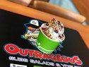 Outrageous Subs & Salads Logo
